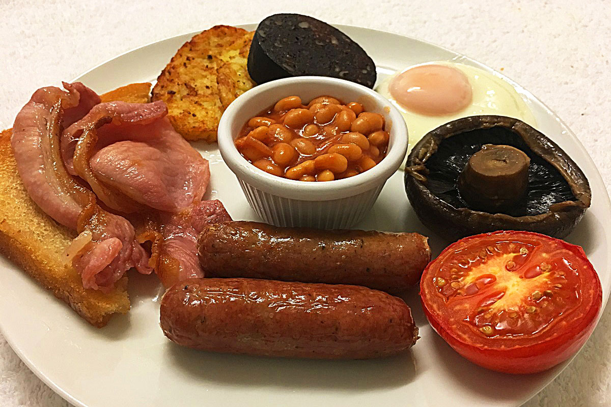 full english breakfast with black pudding and flat mushroom