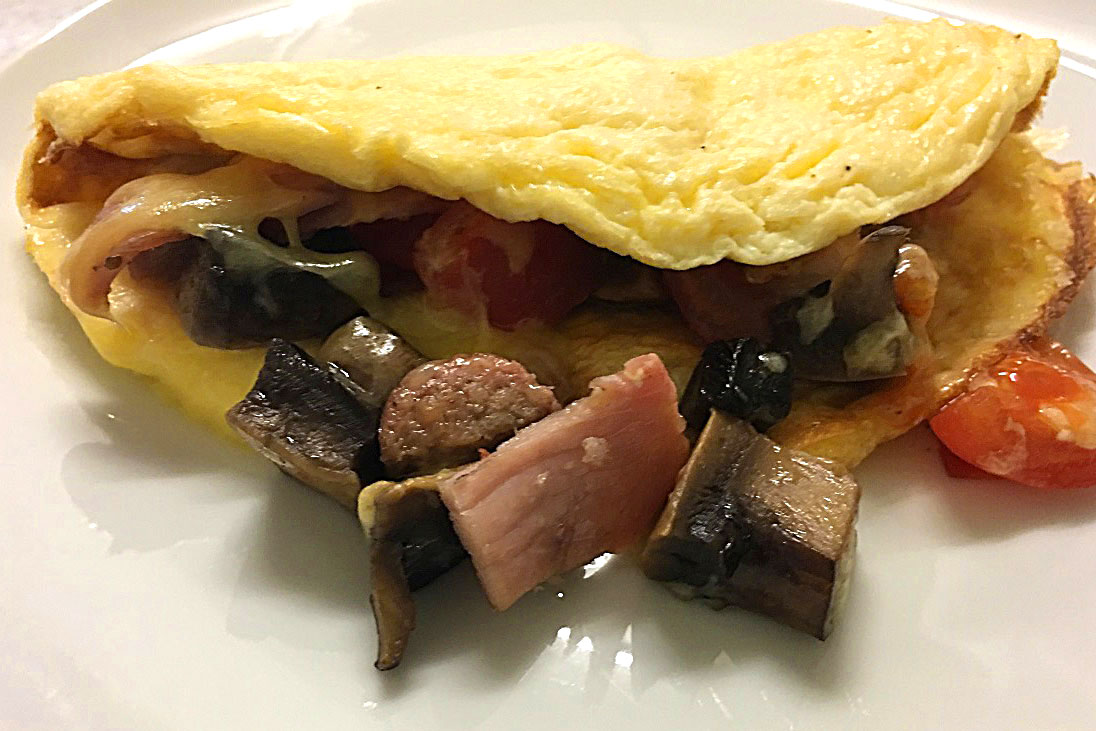omelette with cheese bacon mushroom tomato